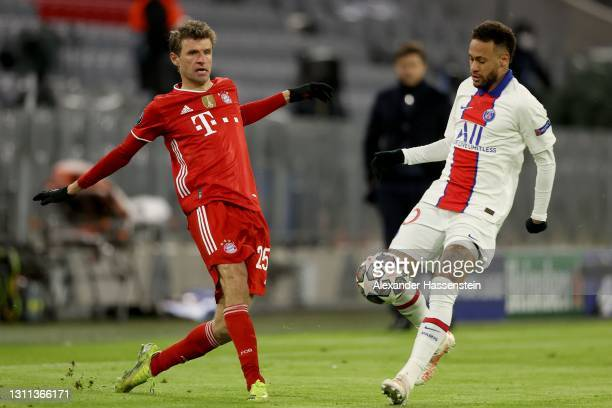 Thomas Muller of FC Bayern Munich is closed down by Neymar of Paris Saint-Germain during the UEFA Champions League Quarter Final match between FC...