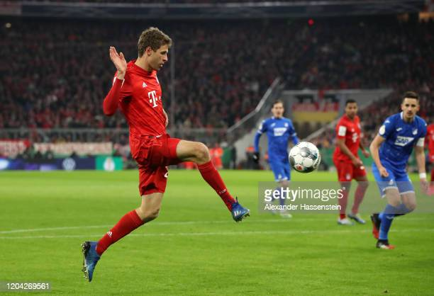 Thomas Muller of FC Bayern Munich passes the ball during the DFB Cup round of sixteen match between FC Bayern Muenchen and TSG 1899 Hoffenheim at...