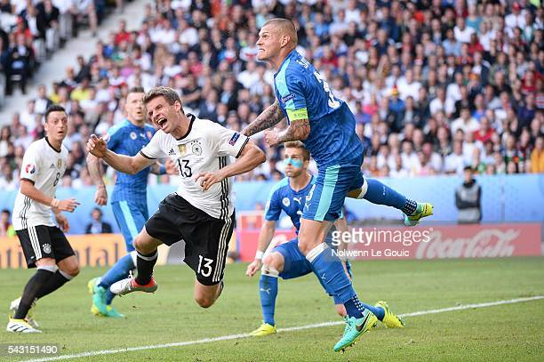 Thomas Muller of Germany and Martin Skrtel of Slovakia during the European Championship match Round of 16 between Germany and Slovakia at Stade...