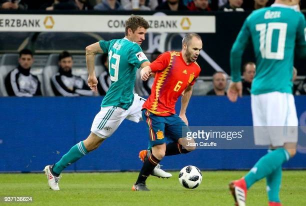 Thomas Muller of Germany Andres Iniesta of Spain during the international friendly match between Germany and Spain at EspritArena on March 23 2018 in...