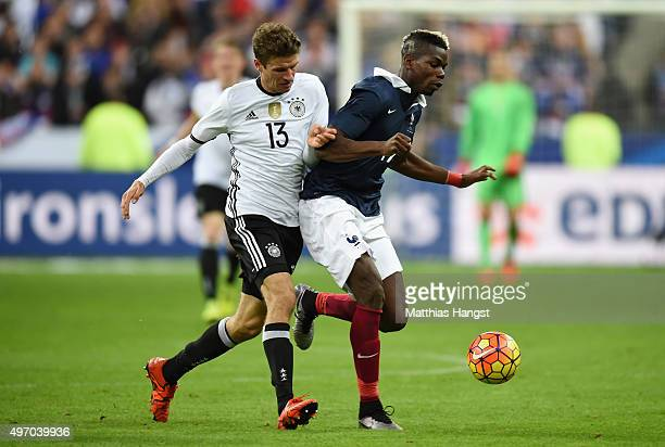 Thomas Muller of Germany battles for the ball with Paul Pogba of France during the International Friendly match between France and Germany at the...