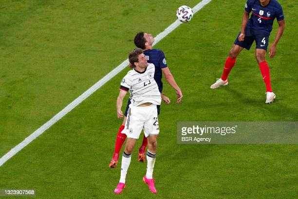 Thomas Muller of Germany, Benjamin Pavard of France during the UEFA Euro 2020 match between France and Germany at Allianz Arena on June 15, 2021 in...