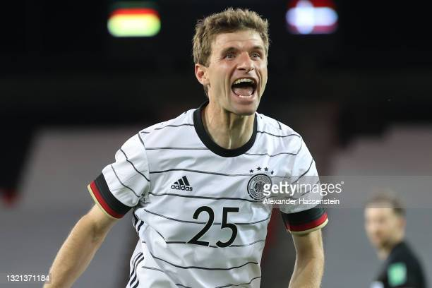 Thomas Muller of Germany celebrates their side's first goal scored by Florian Neuhaus of Germany during the international friendly match between...
