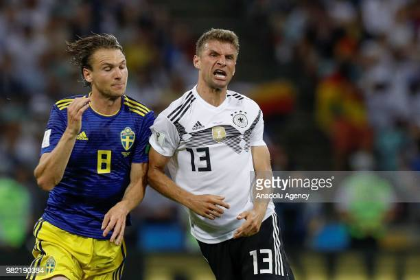 Thomas Muller of Germany struggles with his competitor Albin Ekdal of Sweden during the 2018 FIFA World Cup Russia Group F match between Germany and...