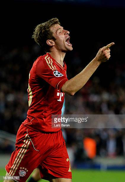 Thomas Muller of Munich celebrates after scoring his team's third goal during the UEFA Champions League semi final second leg match between Barcelona...
