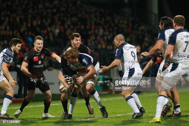 Thomas Murday of Agen and Jean Marcellin Buttin of Lyon and Enrico Januarie of Agen and Toby Carter Arnold of Lyon during the Top 14 match between...