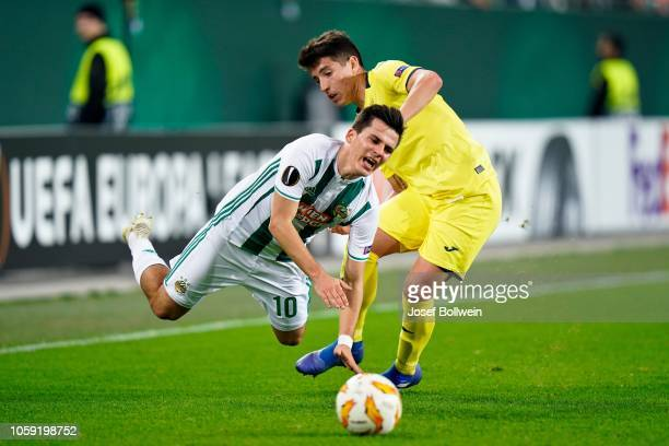 Thomas Murg of Rapid and Santiago Caseres of Villarreal during the tUEFA Europa League match between SK Rapid Wien v Villarreal CF at Weststadion on...