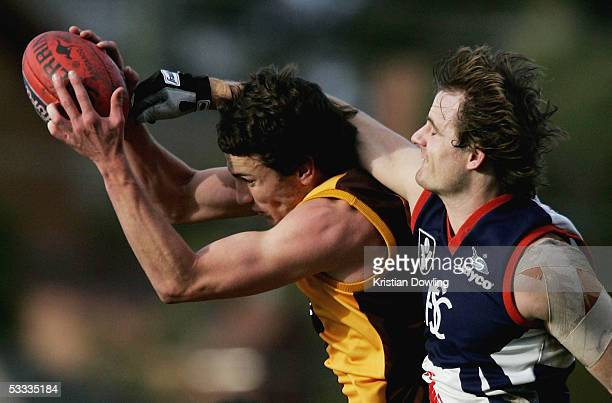 Thomas Murphy for the Hawks and Ben Heenan for the Scorpions in action during the Round 18 VFL match between the Box Hill Hawks and the Scorpions at...