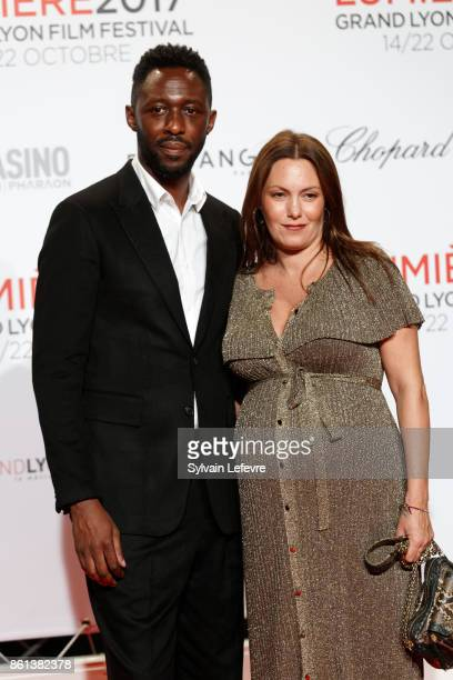 Thomas Ngijol and his wife Karole Rocher attend opening ceremony of 9th Film Festival Lumiere In Lyon on October 14 2017 in Lyon France