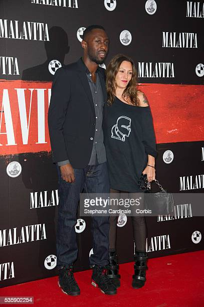 Thomas N'Gijol and Karole Rocher attend the 'Malavita' premiere at Europacorp Cinemas at Aeroville Shopping Center in RoissyenFrance France