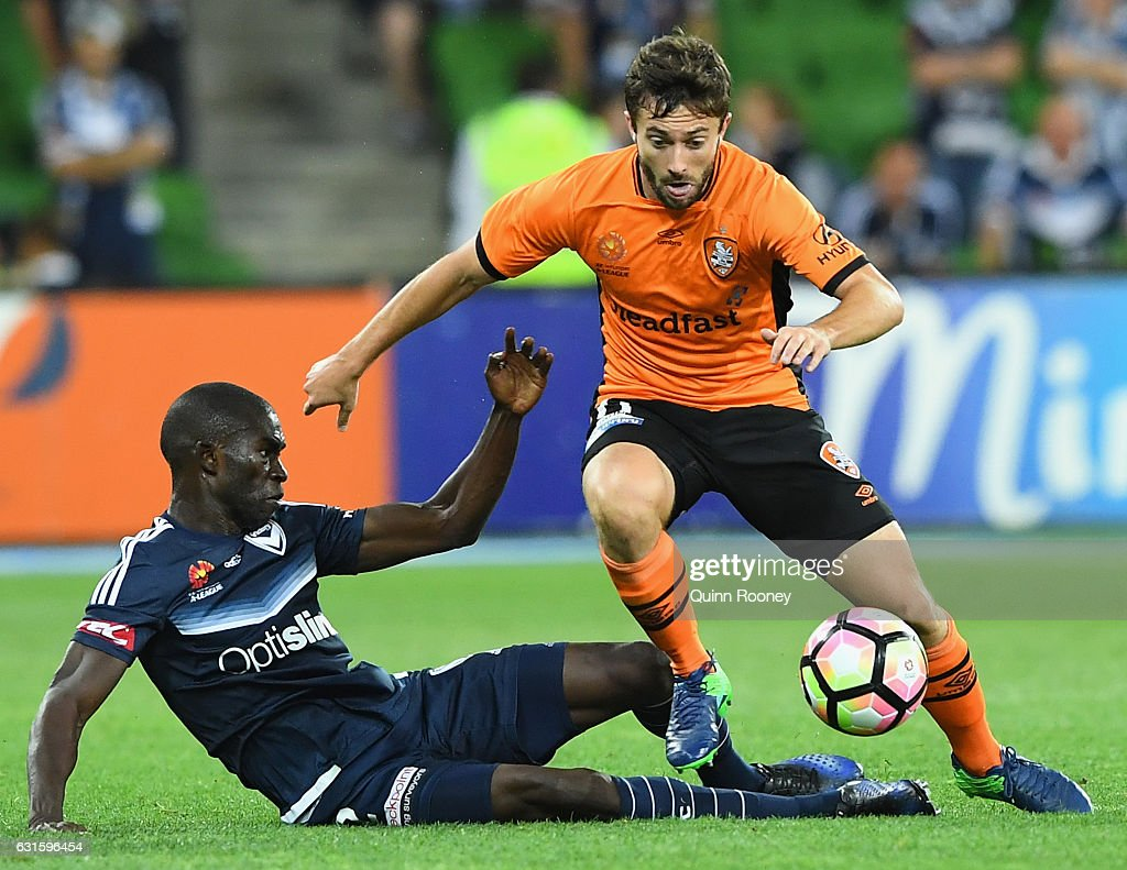 Thomas Oar of the Roar is tackled by Jason Geria of the Victory during the round 15 A-League match between the Melbourne Victory and the Brisbane Roar at AAMI Park on January 13, 2017 in Melbourne, Australia.