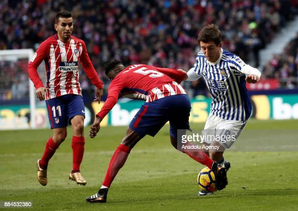 Thomas of Atletico de Madrid in action against Mikel Oyarzabal of Real Sociedad during the La Liga match between Club Atletico Madrid and Real...