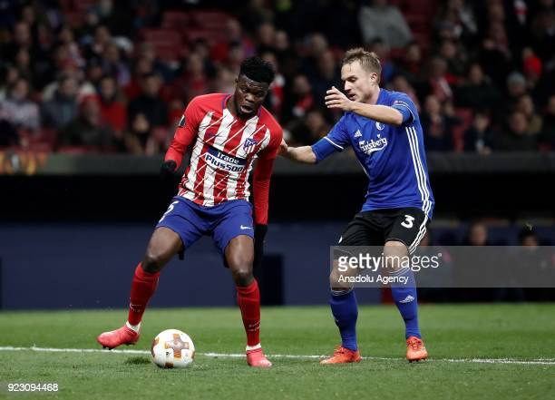 Thomas of Atletico Madrid in action against Pierre Bengtsson of FC Copenhagen during the UEFA Europa League Round of 32 second leg soccer match...