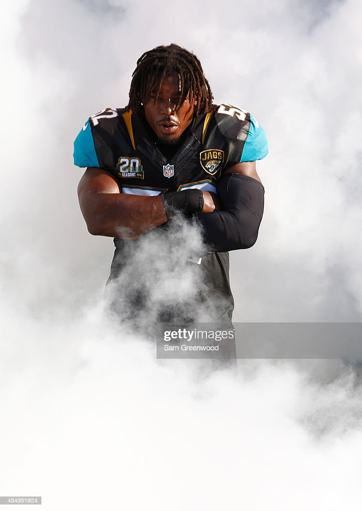 J.T. Thomas #52 of the Jacksonville Jaguars enters the stadium before the preseason NFL game against the Atlanta Falcons at EverBank Field on August 28, 2014 in Jacksonville, Florida.