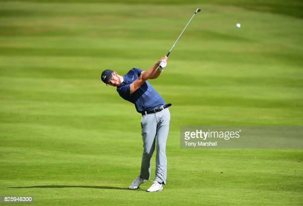 Thomas Ogilvie of Dukes Course St Andrews plays his second shot on the 1st fairway during Day Two of the Galvin Green PGA Assistants' Championship at...