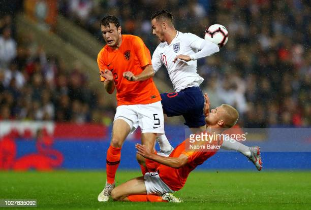 Thomas Ouwejan and Rick Van Drongelen of the Netherlands compete for the ball with James Maddison of England during the 2019 UEFA European Under 21...