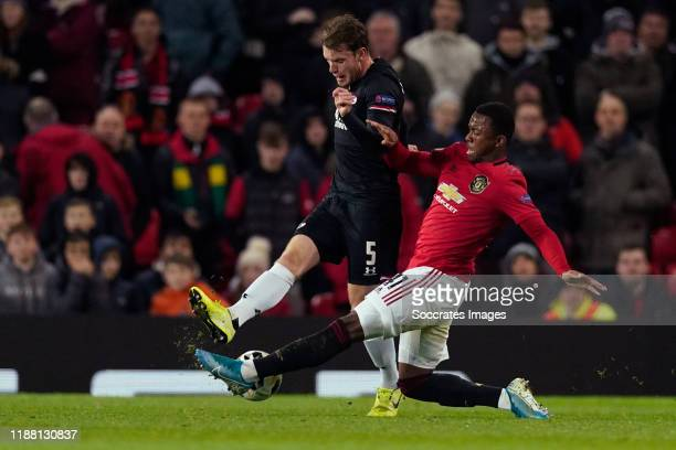 Thomas Ouwejan of AZ Alkmaar Ethan Laird of Manchester United during the UEFA Europa League match between Manchester United v AZ Alkmaar at the Old...