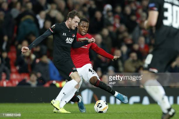 Thomas Ouwejan of AZ Alkmaar Ethan Laird of Manchester United during the UEFA Europa League group L match between Manchester United and AZ Alkmaar at...
