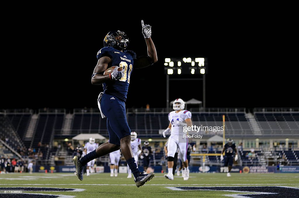 Thomas Owens Of The Fiu Panthers Gestures After Scoring A Touchdown