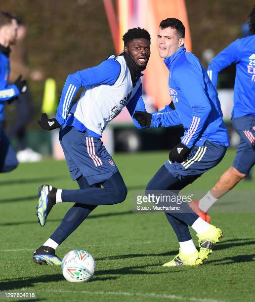 Thomas Partey and Granit Xhaka of Arsenal during a training session at London Colney on January 22, 2021 in St Albans, England.