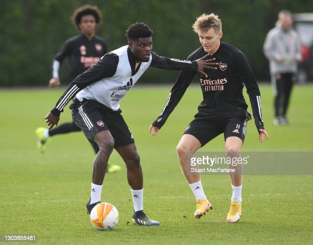 Thomas Partey and Martin Odegaard of Arsenal during a trining session at London Colney on February 24, 2021 in St Albans, England.