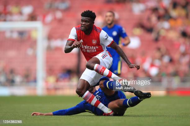 Thomas Partey of Arsenal appears to injure his ankle in this challenge from Ruben Loftus-Cheek of Chelsea during the Pre Season Friendly between...