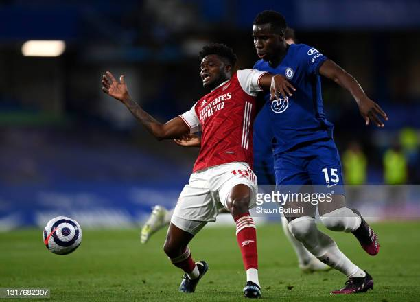 Thomas Partey of Arsenal battles for possession with Kurt Zouma of Chelsea during the Premier League match between Chelsea and Arsenal at Stamford...