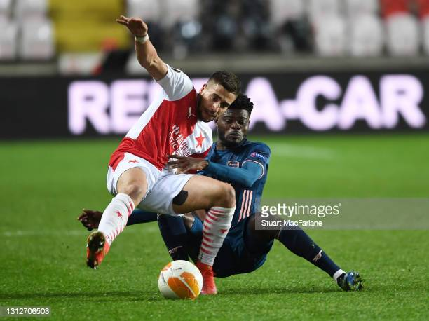 Thomas Partey of Arsenal challenges Ondrej Lingr of Slavia Pragu during the UEFA Europa League Quarter Final Second Leg match between Slavia Praha...