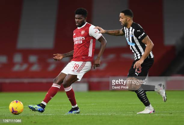 Thomas Partey of Arsenal passes the ball under pressure from Callum Wilson of Newcastle during the Premier League match between Arsenal and Newcastle...