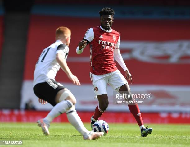 Thomas Partey of Arsenal takes on Harrison Reed of Fulham during the Premier League match between Arsenal and Fulham at Emirates Stadium on April 18,...