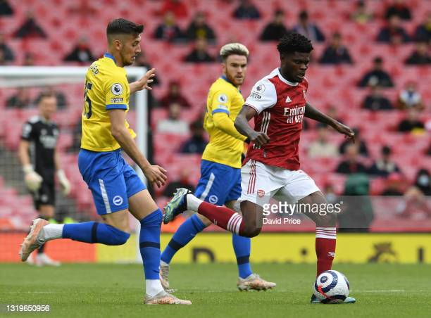 Thomas Partey of Arsenal takes on Jakub Molder of Brighton during the Premier League match between Arsenal and Brighton & Hove Albion at Emirates...