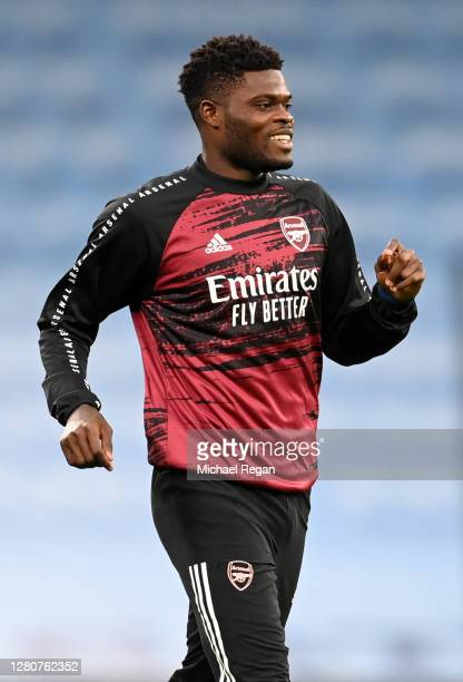 Thomas Partey of Arsenal warms up prior to the Premier League match between Manchester City and Arsenal at Etihad Stadium on October 17, 2020 in...