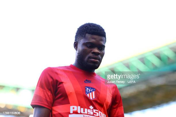 Thomas Partey of Atletico de Madrid looks on prior to during the UEFA Champions League Quarter Final match between RB Leipzig and Club Atletico de...