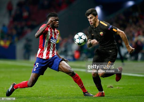 Thomas Partey of Atletico Madrid and Diego Perotti of AS Roma battle for possession during the UEFA Champions League group C match between Atletico...