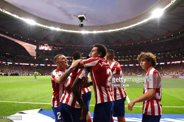 Thomas Partey of Atletico Madrid celebrates with Jose Maria Gimenez and teammates after scoring his team's third goal during the Liga match between...