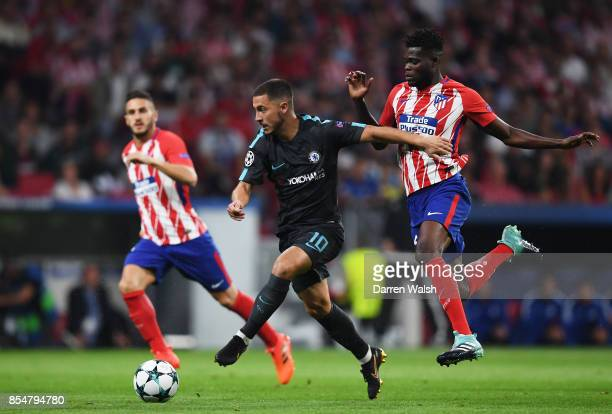 Thomas Partey of Atletico Madrid chases down Eden Hazard of Chelsea during the UEFA Champions League group C match between Atletico Madrid and...