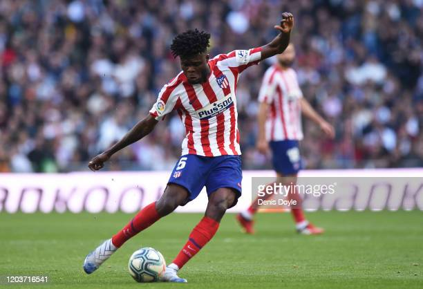 Thomas Partey of Atletico Madrid crosses the ball during the Liga match between Real Madrid CF and Club Atletico de Madrid at Estadio Santiago...