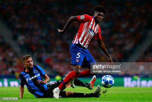 Thomas Partey of Atletico Madrid is challanged by Siebe Schrijvers of Club Brugge during the Group A match of the UEFA Champions League between Club...