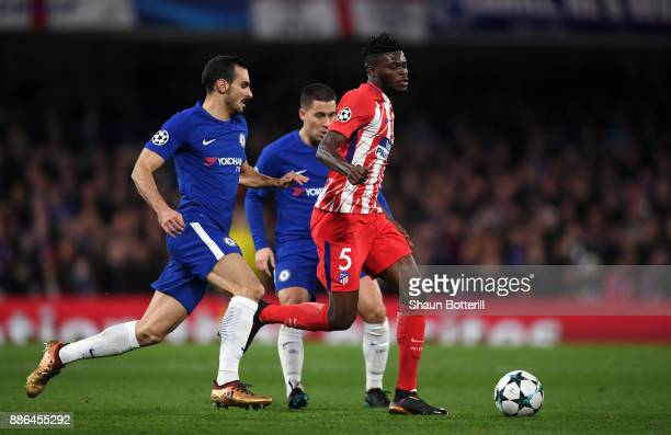 Thomas Partey of Atletico Madrid is challenged by Davide Zappacosta of Chelsea during the UEFA Champions League group C match between Chelsea FC and...