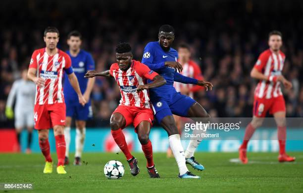 Thomas Partey of Atletico Madrid is challenged by Tiemoue Bakayoko of Chelsea during the UEFA Champions League group C match between Chelsea FC and...