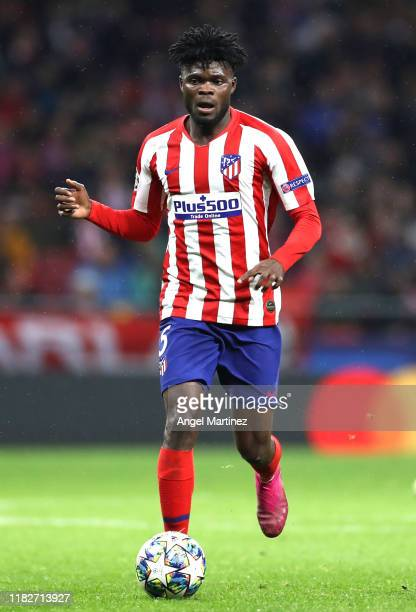Thomas Partey of Atletico Madrid runs with the ball during the UEFA Champions League group D match between Atletico Madrid and Bayer Leverkusen at...