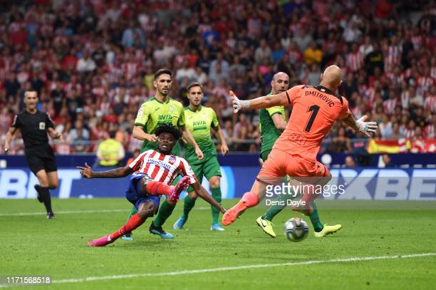 Thomas Partey of Atletico Madrid scores his team's third goal past Marko Dmitrovic of SD Eibar during the Liga match between Club Atletico de Madrid...