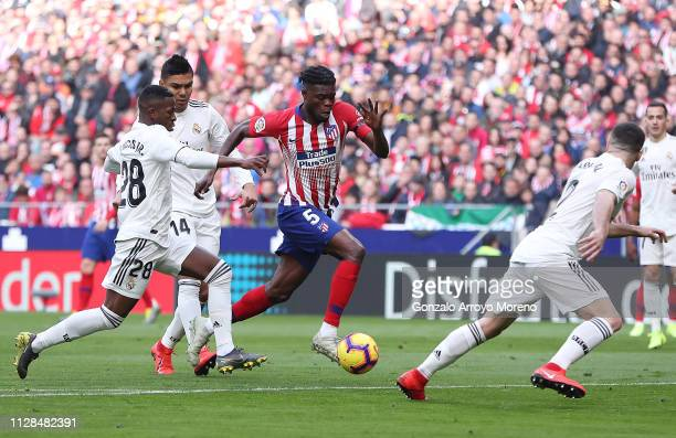 Thomas Partey of Atletico Madrid takes on Vinicius Junior and Daniel Carvajal of Real Madrid during the La Liga match between Club Atletico de Madrid...