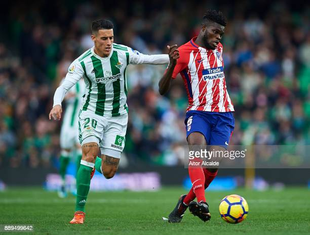 Thomas Partey of Club Atletico de Madrid being followed by Cristian Tello of Real Betis Balompie during the La Liga match between Real Betis and...
