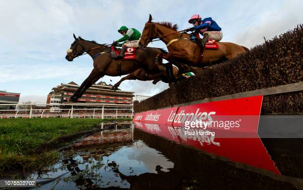 Thomas Patrick ridden by Richard Johnson and Dingo Dollar ridden by Wayne Hutchinson are first over the water jump during the 1500 Ladbrokes Trophy...