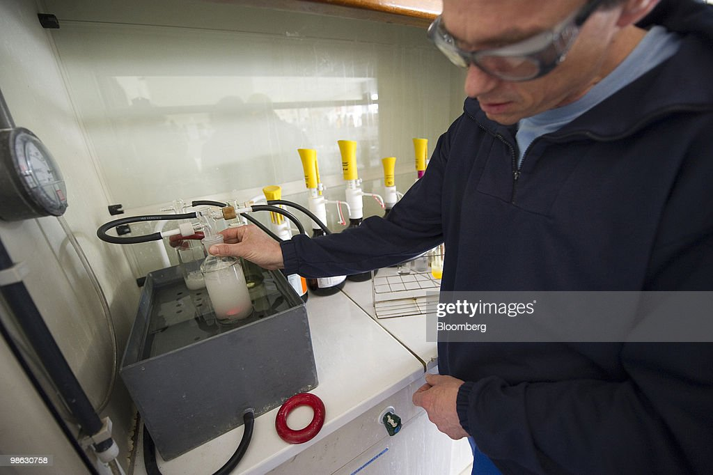 Thomas Pauwels, a chemist with Solvay SA, breaks down a sample of liquid chlorine in the laboratory at the company's chemical plant in Antwerp, Belgium, on Thursday, April 22, 2010. Confidence within Europe�s chemical industry has risen for the first time in 21 months, ICIS news reported, citing data from the European Chemical Industry Council. Photographer: Jock Fistick/Bloomberg via Getty Images