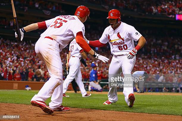 Thomas Pham of the St Louis Cardinals celebrates with Stephen Piscotty of the St Louis Cardinals after hitting a solo home run in the eighth inning...