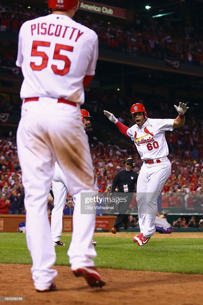 Thomas Pham #60 of the St. Louis Cardinals celebrates with Stephen Piscotty #55 of the St. Louis Cardinals after hitting a solo home run in the eighth inning against the Chicago Cubs during game one of the National League Division Series at Busch Stadium on October 9, 2015 in St Louis, Missouri.