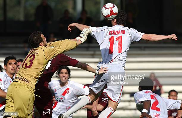 Thomas Pichlmann of US Grosseto and goalkeeper Piero Robertiello of Salernitana Calcio compete for the ball during the Serie B match between...