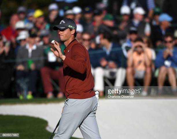 Thomas Pieters acknowledges applause after sinking a putt on the 18th green during the second round of the Masters Tournament at Augusta National...